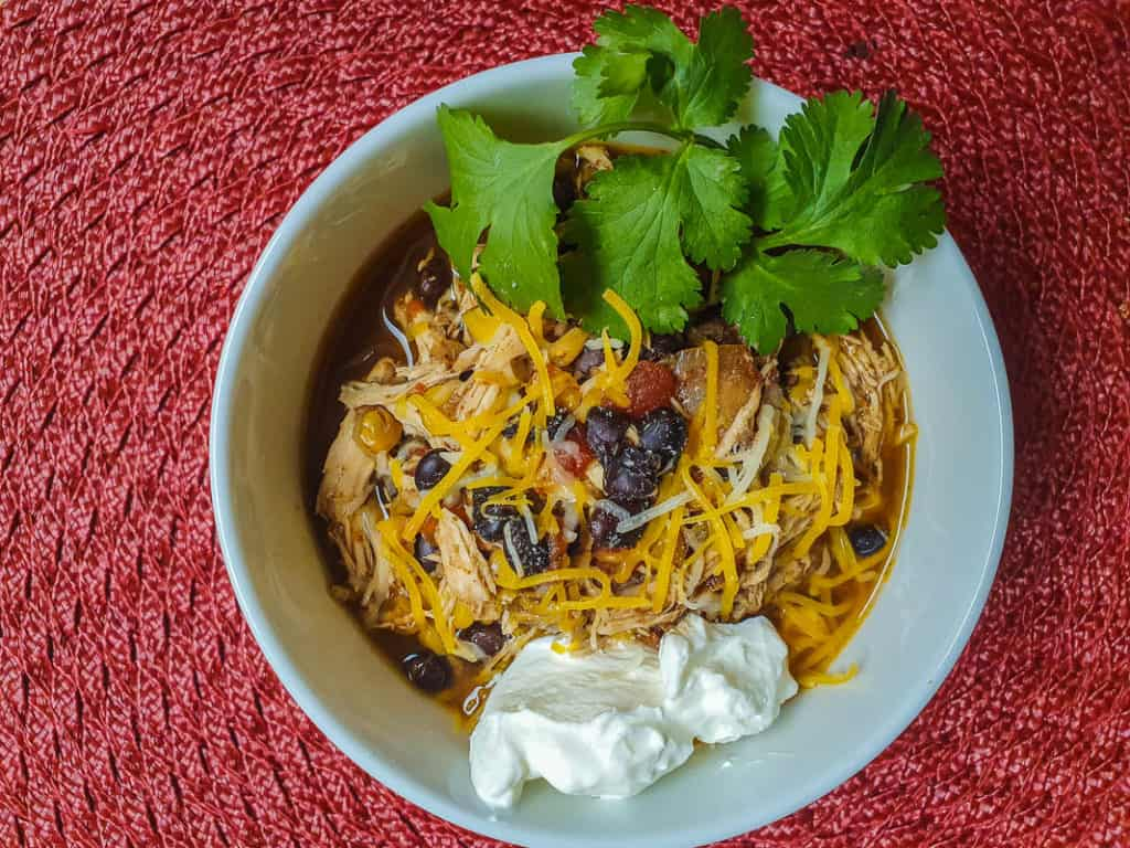Chicken chili with cheese and sour cream