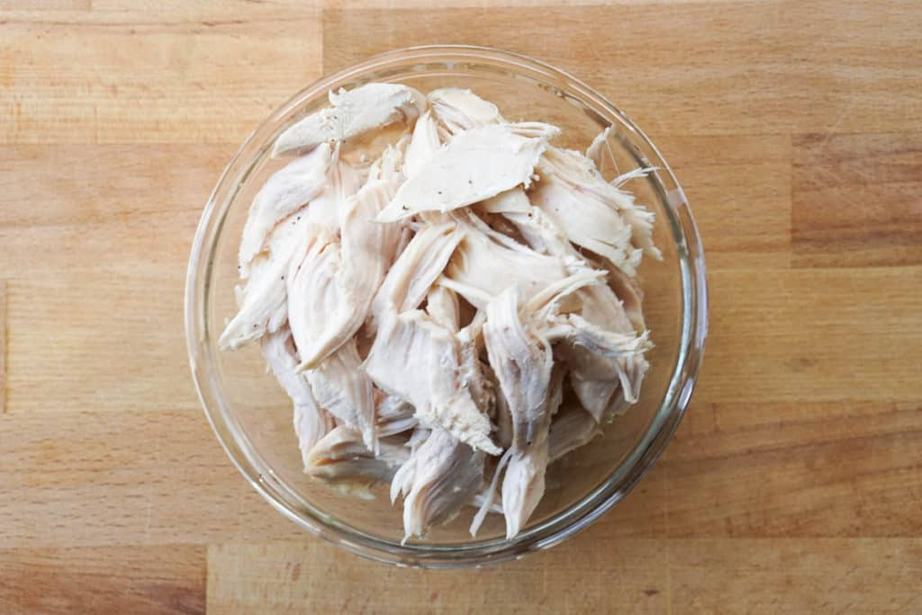 Shredded chicken in noodle soup