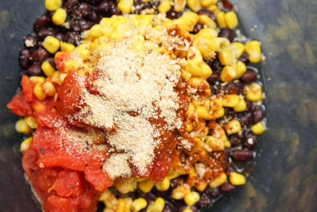 Adding seasoning to stuffed peppers