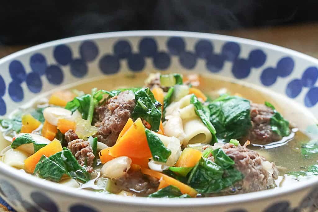 serving Italian wedding soup