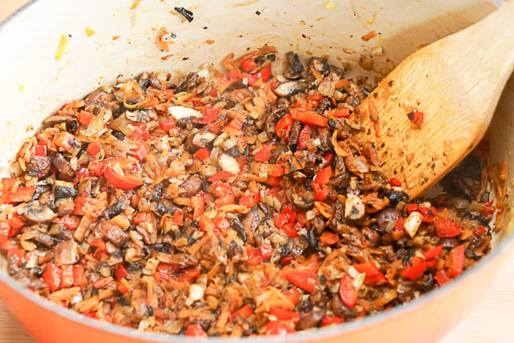 cooking lentil mushroom ragu on a stove top